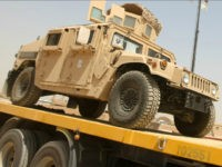 US army Humvees are loaded into trucks during a logistical operation to clear equipment and heavy machinery as part of pulling out of Iraq, at the Balad military base, north of Baghdad, on August 27, 2010 a week before the US military is due to end its combat mission in …