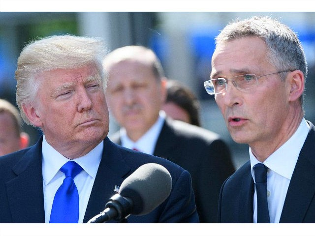US President Donald Trump (L) listens to a speech by NATO Secretary General Jens Stoltenberg during the unveiling ceremony of the new NATO headquarters in Brussels, on May 25, 2017, during a NATO (North Atlantic Treaty Organization) summit. / AFP PHOTO / POOL AND BELGA / Christophe LICOPPE (Photo credit should read CHRISTOPHE LICOPPE/AFP/Getty Images)