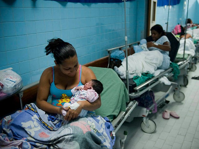 TO GO WITH AFP STORY BY LISSY DE ABREU Mothers and their newborns rest in a maternity center in Caracas, on December 15, 2011. According to the World Health Organization, Venezuela holds the first place in South America in cases of early pregnancy, with about 1,500 children born daily from teenage mothers aged between 12 and 19 years. AFP PHOTO / Leo RAMIREZ (Photo credit should read LEO RAMIREZ/AFP/Getty Images)