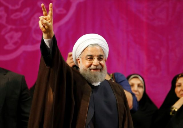 Iran's President Hassan Rouhani appears at a campaign rally in Tehran on May 9, 2017