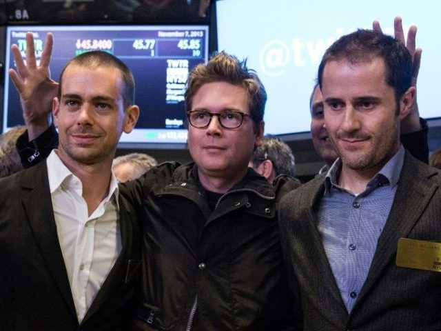 Twitter co-founder Biz Stone, at center in 2013 photo at the New York Stock Exchange debut of the social network, is flanked by co-founders Jack Dorsey, at left, and Ev Williams. Stone is returning to work at Twitter after a six-year hiatus