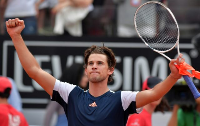 Austria's Dominic Thiem celebrates after defeating Spain's Rafael Nadal at the ATP Tennis Open tournament on May 19, 2017