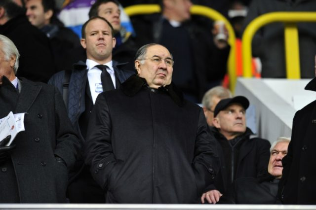 Russian shareholder Alisher Usmanov (C), who owns 30 percent of Arsenal, has already had a previous bid for the Premiere League club rejected