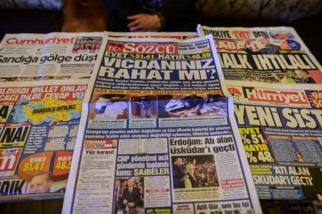 Turkish authorities have reportedly issued arrest warrants for the owner and three employees of opposition daily Sozcu seen displayed with other papers on an Istanbul newsstand