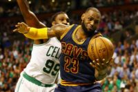 LeBron James of the Cleveland Cavaliers battles for the ball with Jae Crowder of the Boston Celtics in Game Two of the 2017 NBA Eastern Conference finals, at TD Garden in Boston, Massachusetts, on May 19