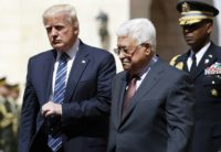 US President Donald Trump (L) is welcomed by Palestinian leader Mahmud Abbas at the presidential palace in the West Bank city of Bethlehem on May 23, 2017