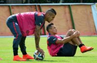 Chile forwards Arturo Vidal (left) and Alexis Sanchez stretch during a 2014 training session in Belo Horizonte