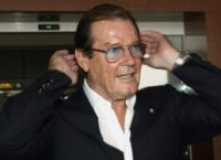 Former James Bond actor Roger Moore pictured at Hanoi airport on October 26, 2003 during a  goodwill ambassador visit for the United Nations Children's Funds (UNICEF)