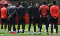 Manchester United players observe a minute's silence for the victims of yesterday's terror attack at the Manchester Arena, during a training session at the club's training complex near Carrington, on May 23, 2017