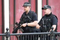 Armed police patrol near Manchester Arena on May 23, 2017 following a terror attack the previous evening