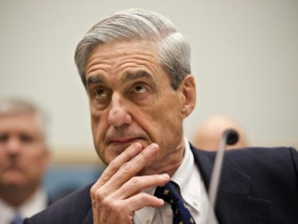FILE - In this June 13, 2012, file photo then-FBI Director Robert Mueller listens as he testifies on Capitol Hill in Washington. Mueller took office as FBI director in 2001 expecting to dig into drug cases, white-collar misdeeds and violent crime. A week later was Sept. 11. Overnight, his mission …