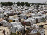 FILE- This Sunday Aug. 28, 2016 file photo shows a general view of one of the biggest camp for people displaced by Islamist Extremist in Maiduguri, Nigeria. Camps for thousands of people displaced by Boko Haram will have to stay open beyond the end of this month as Nigeria's military …