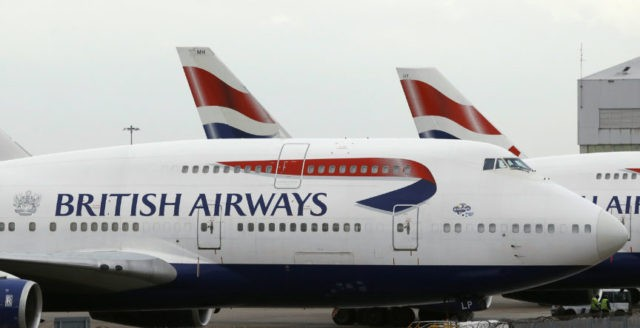 Passengers wait for BA flights at Heathrow after IT crash