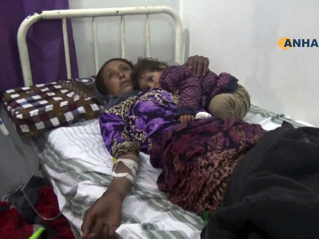 This frame grab from video provided by the Hawar News Agency, shows a woman wounded in an attack by the Islamic State group, in bed at a clinic in Hasakeh province, Syria, Tuesday, May 2, 2017. Islamic State militants staged a surprise attack early Tuesday at a crossing frequently used …