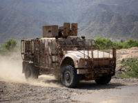 A picture taken on May 19, 2017 in Yemen's third-city of Taez shows an armoured vehicle belonging to Yemeni fighters supporting forces loyal to Yemen's Saudi-backed President Abedrabbo Mansour Hadi guarding a position during clashes with Shiite Huthi rebels. / AFP PHOTO / Ahmad AL-BASHA (Photo credit should read AHMAD …