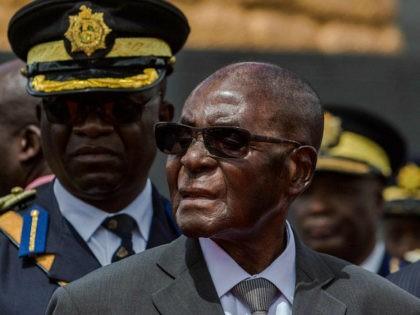 Zimbabwe's President Robert Mugabe attends the burial of Brigadier General James Murozvi, who was granted national hero status by President Robert Mugabe, at the National Heroes Acre in Harare, on April 12, 2017. / AFP PHOTO / Jekesai NJIKIZANA (Photo credit should read JEKESAI NJIKIZANA/AFP/Getty Images)