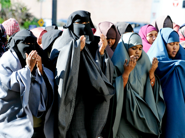 Women in traditional Muslim dress take part in prayers outside the federal courthouse, Oct. 20, 2011, in Minneapolis