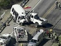 In this aerial image made from a video provided by KABB/WOAI authorities respond to a deadly crash involving a van carrying church members and a pickup truck on U.S. 83 outside Garner State Park in northern Uvalde County, Texas, Wednesday, March 29, 2017. The group of senior adults from First …
