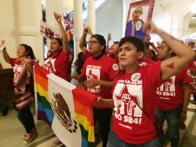 "Demonstrators march in the Texas Capitol on Monday, May 29, 2017, protesting the state's newly passed anti-sanctuary cities bill in Austin, Texas. Opponents call Texas' anti-sanctuary cities law a ""show your papers"" law since it empowers police to inquire about peoples' immigration status during routine interactions such as traffic stops. …"