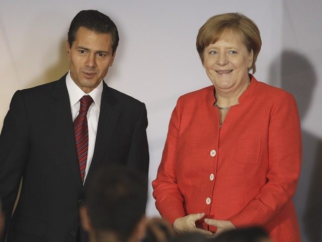 German Chancellor Angela Merkel, right, and Mexican President Enrique Pena Nieto attend a meeting with Mexican business leaders at the Interactive Economics Museum in Mexico City, Mexico, Saturday June 10, 2017. Merkel is in a two-day visit to Mexico. (AP Photo/Rebecca Blackwell)