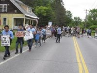 "Scores of dairy farm workers and activists marching in Montpelier, Vt., on Saturday June, 17, 2017. They were marching to the main Ben & Jerry's factory in the Vermont town of Waterbury to protest what they feel are slow negotiations to reach a deal on their ""Milk with Dignity"" program …"