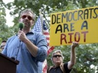 "Mike Cernovich, left, a right-wing author and attorney, speaks during a rally outside the White House in Washington, Sunday, June 25, 2017. Cernovich was one of many speakers at the ""Rally Against Political Violence,"" that was to condemn the attack on Republican congressmen during their June 14 baseball practice in …"
