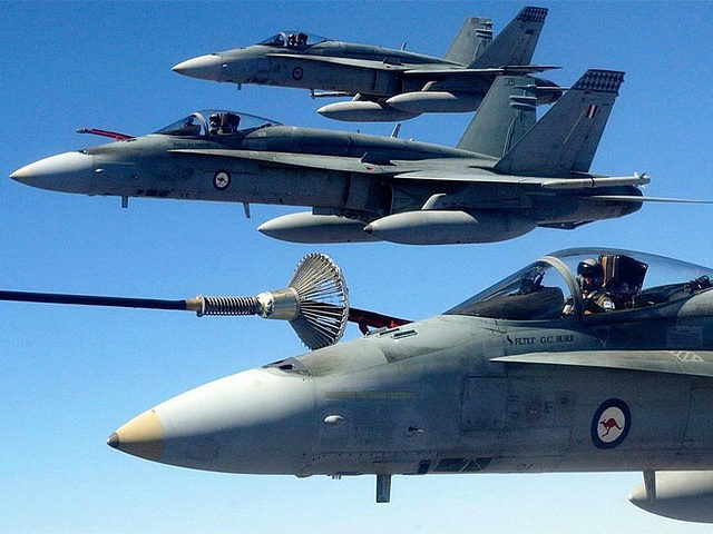 """Three Australian Air Force (RAAF) F/A-18 Hornet fighter jets perform air-to-air refuelling while participating in """"Exercise Pitch Black"""" near Darwin in this July 20, 2004 handout photograph. Exercise Pitch Black is a biennial 18-day event and is the Royal Australian Air Force's largest exercise, involving about 1,700 personnel from Singapore, …"""