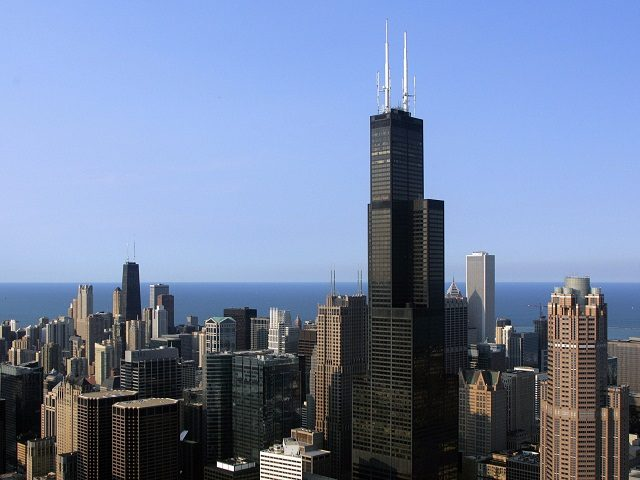 The Chicago skyline featuring the Sears Tower is seen from a helicopter 06 July 2006 in Chicago, Illinois. The tower, the tallest in North America was the tallest in the world until 1996. The tower is third behind the Petronas Towers in Malaysia. AFP PHOTO/TIM SLOAN (Photo credit should read …