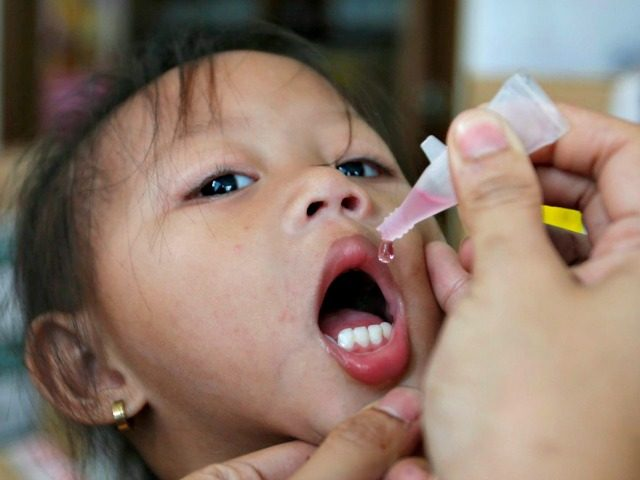 A girl receives anti-measles vaccination drops at a health centre in BASECO compound in Tondo, Manila September 3, 2014. Philippine President Benigno Aquino said on September 1, 2014 between 11 to 13 million people in the country are at risk from measles, polio and rubella (German measles), and asked the …