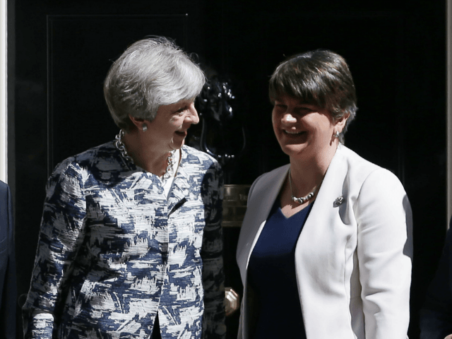 Britain's Prime Minister Theresa May (2L) poses for a picture with Democratic Unionist Party (DUP) leader Arlene Foster (2R), DUP Deputy Leader Nigel Dodds (L) and DUP MP Jeffrey Donaldson at 10 Downing Street in central London on June 26, 2017.