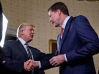 Donald-Trump-James-Comey-handshake-Jan-22-2017-Getty