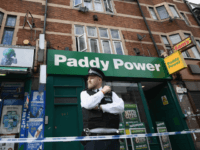 A police officer stands outside a block of flats over shops in East Ham, one of which has been raided by police earlier today on June 4, 2017 in London, England.