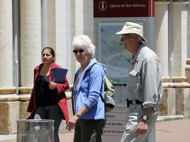 A couple of foreigners walk in downtown Cuenca, Ecuador, on November 6, 2010. Many foreign retired people --specially from the US-- are settling in the city of Cuenca, looking for a cheap and calm place to spend their oldness. AFP PHOTO / Rodrigo BUENDIA (Photo credit should read RODRIGO BUENDIA/AFP/Getty …