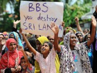 Sri Lankan muslims, made homeless after two days of anti-muslim riots in Sri Lankas tourist region of Alutgama, demonstrate against radical Buddhist group Bodu Bala Sena (BBS)at a makeshift camp in Beruwala, about 58 kms south of capital Colombo on June 18, 2014. The Buddhist Force, or BBS, is widely …