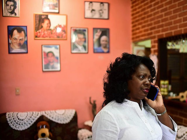 Cuban dissident, leader of the Human Rights organization Ladies in White, Berta Soler, speaks during a interview in Havana, on November 27, 2016, two days after the death of Cuban revolutionary leader Fidel Castro. Cuban revolutionary icon Fidel Castro died late November 25 in Havana, his brother, President Raul Castro, …