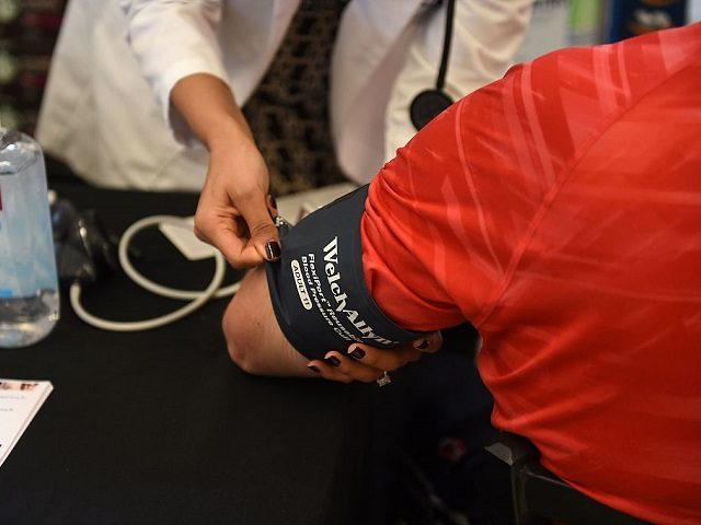 """Physician Assitant Marina Sarwary (L) takes a shopper's blood pressure as part of the """"Shop with a Doc"""" program, November 28, 2016 at a Ralph's Supermarket in Irvine, California. """"Shop with a Doc"""" is a community health program from St. Joseph Hoag Health hospital group which brings medical professionals and …"""