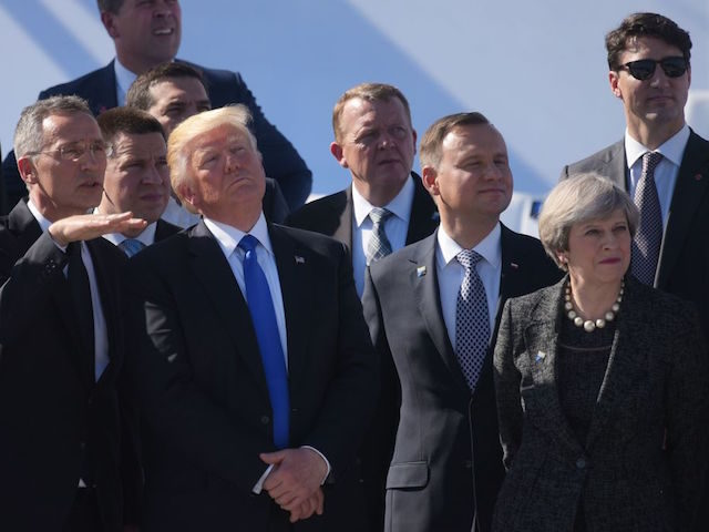 (L-R) NATO Secretary General Jens Stoltenberg, US President Donald Trump and Britain's Prime Minister Theresa May watch a flyover during the handover ceremony at the new NATO Headquarters in Brussels on May 25, 2017. / AFP PHOTO / MANDEL NGAN (Photo credit should read MANDEL NGAN/AFP/Getty Images)
