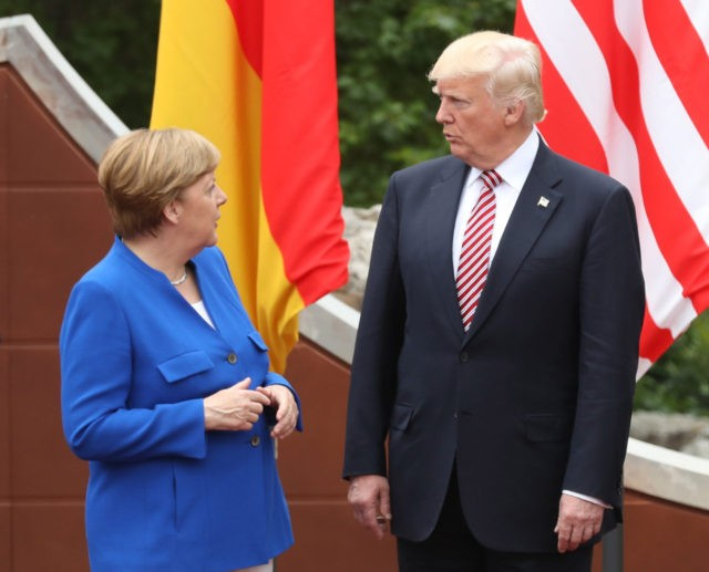 TAORMINA, ITALY - MAY 26: German Chancellor Angela Merkel and U.S. President Donald Trump arrive for the group photo at the G7 Taormina summit on the island of Sicily on May 26, 2017 in Taormina, Italy. Following the summit Chancellor Merkel expressed her disappointment that the Trump administration was unwilling …