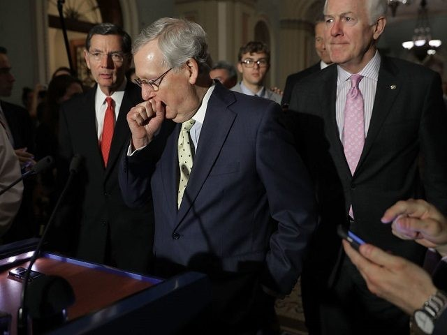 U.S. Senate Majority Leader Mitch McConnell (R-KY) (C) approaches the microphones before talking with reporters with Sen. John Barrasso (R-WY) (L) and Senate Majority Whip John Cornyn (R-TX) following the weekly GOP policy luncheon at the U.S. Capitol June 20, 2017 in Washington, DC. Senate Republicans said that Democrats were not invited to participate in the writing of new health care legislation to replace Obamacare because they would attempt to obstruct the process. (Photo by Chip Somodevilla/Getty Images)