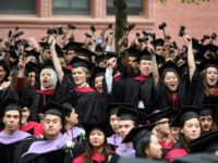 CAMBRIDGE, MA - JUNE 5: Graduating Harvard University Law School students stand and wave gavels in celebration at commencement ceremonies June 5, 2008, in Cambridge, Massachusetts. J.K. Rowling, who wrote the popular Harry Potter books, was the commencement speaker. (Photo by Robert Spencer/Getty Images)