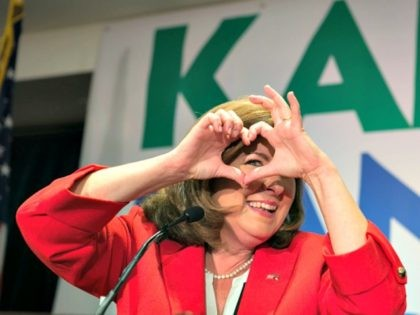 Karen Handel makes a heart guesture.