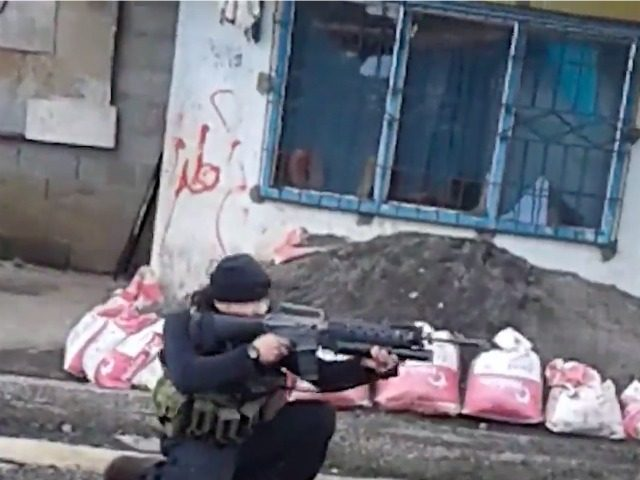 Images previously released by the Islamic State from Marawi showed gunmen patrolling the streets, holding checkpoints, and planting their notorious black banner.