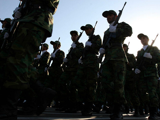 ** FILE ** Members of Iranian Corps Guards of the Islamic Revolution forces parade during large-scale military parades in Tehran to mark the 27th anniversary of the Iraqi invasion of Iran that sparked the bloody 1980-88 war, in Tehran, Iran in this photo taken on Saturday Sep. 22, 2007. They …