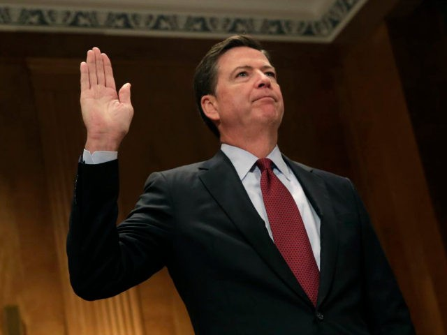 FBI Director James Comey is sworn in before a Senate Committee on Homeland Security and Government Affairs hearing on 'Fifteen Years After 9/11: Threats to the Homeland,' on Capitol Hill in Washington, DC on September 27, 2016. / AFP / YURI GRIPAS (Photo credit should read YURI GRIPAS/AFP/Getty Images)