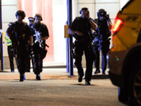 Armed police take position at the scene of a terror attack on London Bridge in central London on June 3, 2017.