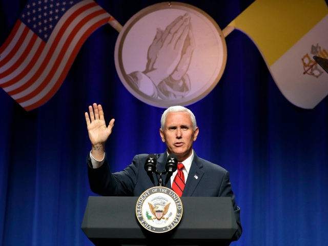 Vice President Mike Pence waves after speaking to the 13th annual National Catholic Prayer Breakfast in Washington, Tuesday, June 6, 2017. (AP Photo/Jacquelyn Martin)