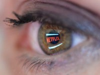 PARIS, FRANCE - SEPTEMBER 19: In this photo illustration the Netflix logo is reflected in the eye of a woman on September 19, 2014 in Paris, France. Netflix September 15 launched service in France, the first of six European countries planned in the coming months. (Photo by Pascal Le Segretain/Getty …