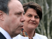 Democratic Unionist Party (DUP) leader Arlene Foster (R), and DUP Deputy Leader Nigel Dodds address the media outside the Parliament Buildings at Stormont in Belfast on March 6, 2017.