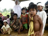 This photo taken on May 19, 2017 shows families from the 'Orang Rimba' tribe -- whose name translates as 'jungle people', gathered around a wooden hut on stilts in the Batang Hari district of Jambi province. Indonesia is home to an estimated 70 million tribespeople, out of a population of …