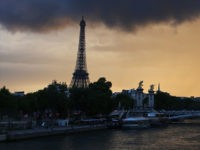 Dark clouds and rain are pictured over Paris and the Eiffel tower at sunset on May 19, 2017. / AFP PHOTO / LUDOVIC MARIN (Photo credit should read LUDOVIC MARIN/AFP/Getty Images)